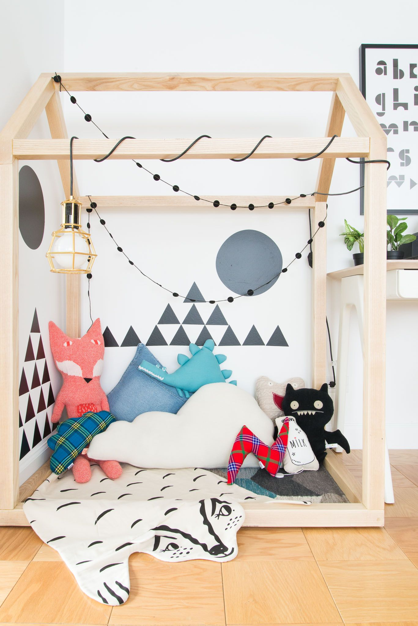 """""""I needed a space to still be able to work and conduct my sourcing while also being able to keep an eye on baby Phoenix. The wonderful guys at <a href=""""roguebuilt.co"""" target=""""_blank"""">Rogue Build</a> made me the little playhouse (which was affectionately named 'the baby cage'). The black white wall stickers are great for him now as he can only see those kinds of stark contrasts. The mounds of toys are for when he is older."""""""