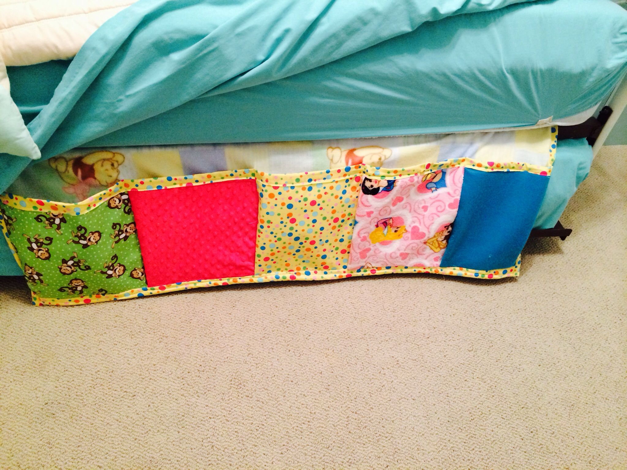 I saw a picture of a bed pockets on Pinterest. My daughter wanted one for my grand daughters room, to put her books and favorite stuffed animals in. I used scrap fabrics from Addy's favorite quilts I already made that matched her room. It turned out pretty cute.  DIY