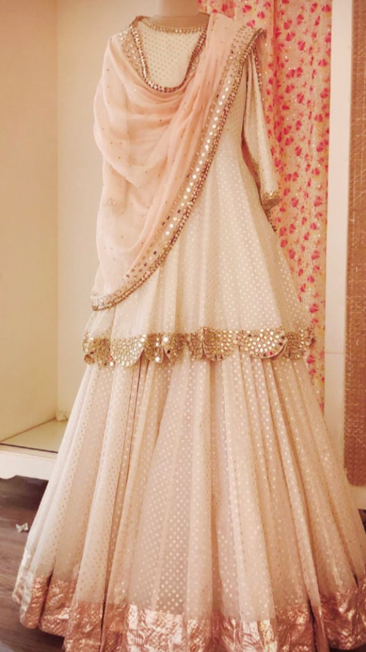 beautifully draped cream and rose gold lehnga-understated