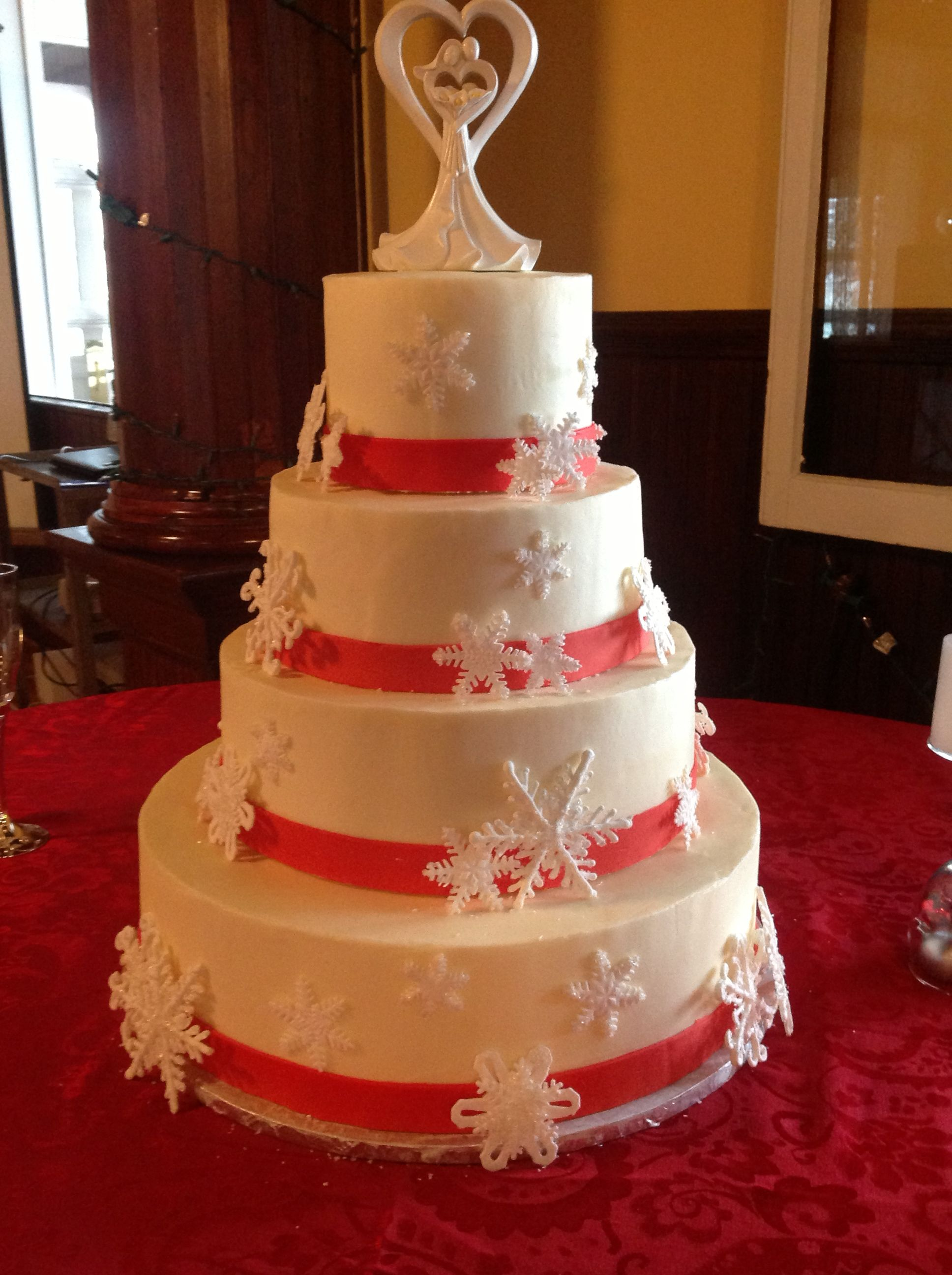 Snowflake wedding cake with sugar paste red bands