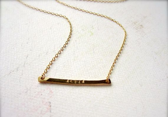 A new twist on the custom stamped name necklace, this handforged 14k Gold Fill skinny banner hangs from a 14k gold fill cable chain with 14k gold fill clasp. Each character is individually stamped by hand.  From Fog + Foundry.  $45