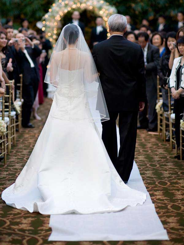 Grandfather Walking Bride Down Aisle