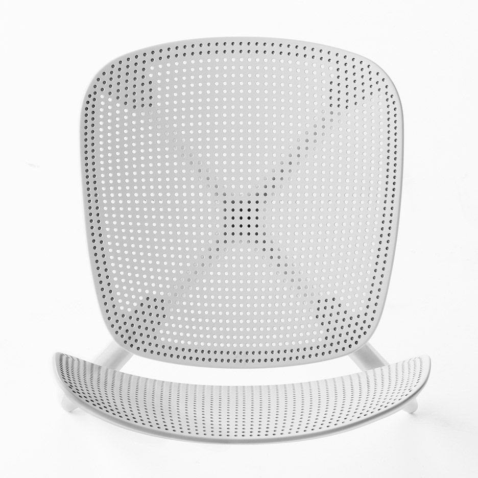 Stackable chair by Patrick Norguet is perforated like a ...