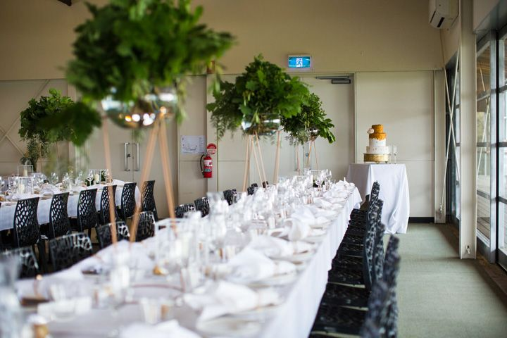 The long lush tables with candles running down the center were met with a large ceiling | Wedding reception | itakeyou.co.uk #weddingtable #longtable #weddingtablescape