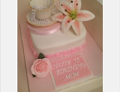 Teacup cake with rose and lily flower for 75th birthday.