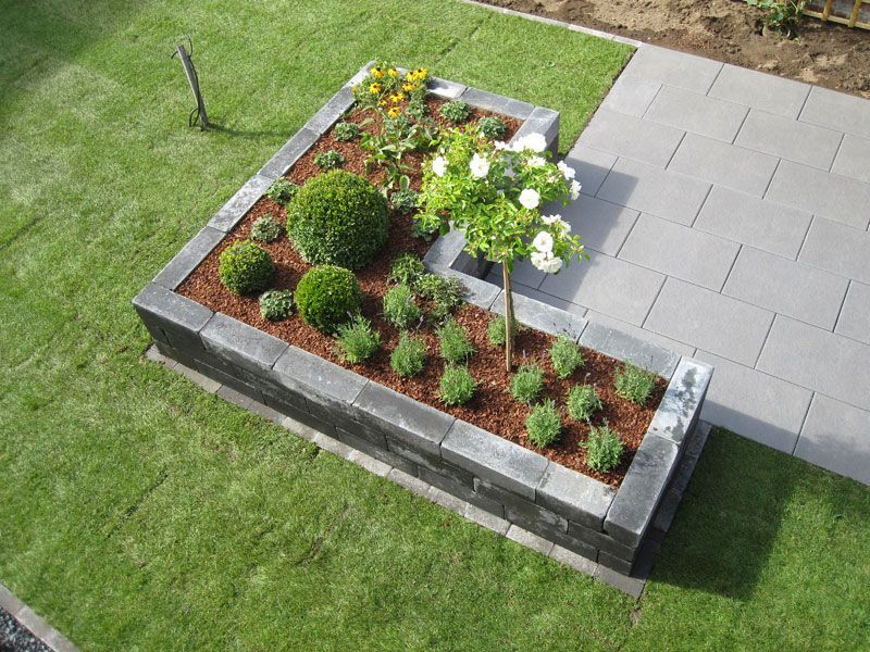 Raised bed photo Grandiflora -  A concrete stone wall looks more appealing – in this case from so-called rumble stones.  - #Bed #ContainerGardening #GardenDesign #Gardening #grandiflora #Landscaping #photo #Plants #raised