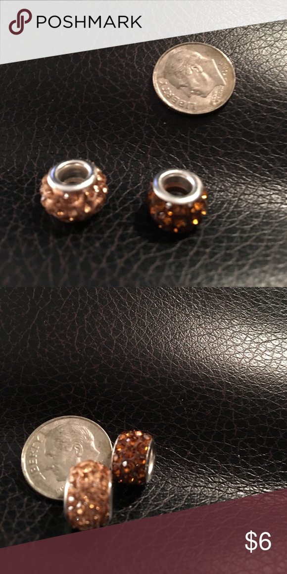 2 European style shiny beads will fit Pandora Two brand-new European style shiny beads will fit Pandora bracelets. Champagne color and brown color.  Fast shipping. Jewelry Bracelets