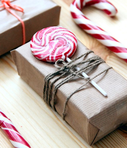 simple and sweet christmas gift wrapping idea put a lolly pop or candy cane under twine and wrap in simple craft paper see the other 49 of our favourite