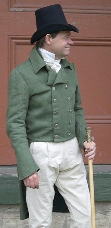 The Empire styling of this tailcoat features a short-waisted, narrow doubled-breasted front, period-correct extra-long sleeves, and long tails. Fully lined. Offered in linen only, color options can be seen on our