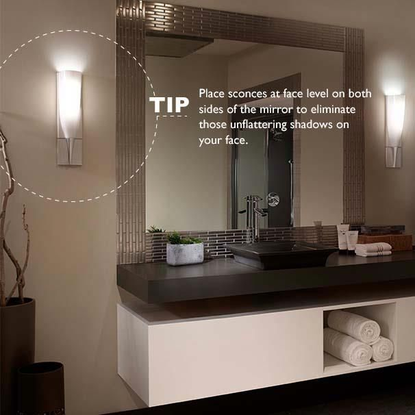 Place #sconces at eye level on either side of mirrors to create the ...