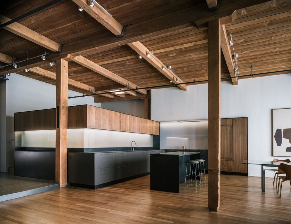 San Francisco Loft in converted warehouse with Douglas Fir timbers. The bedroom is hidden behind the upper kitchen cabinets. [OS][1000x772] : RoomPorn