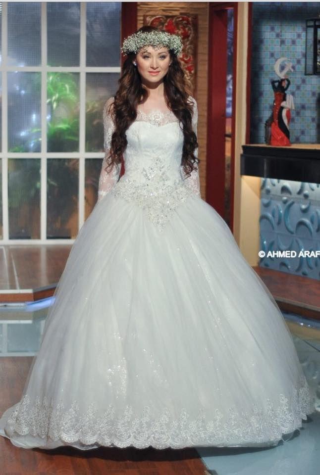 تصميمات مختلفة لفساتين الزفاف من المصمم المصرى نادر نبيل Different ...