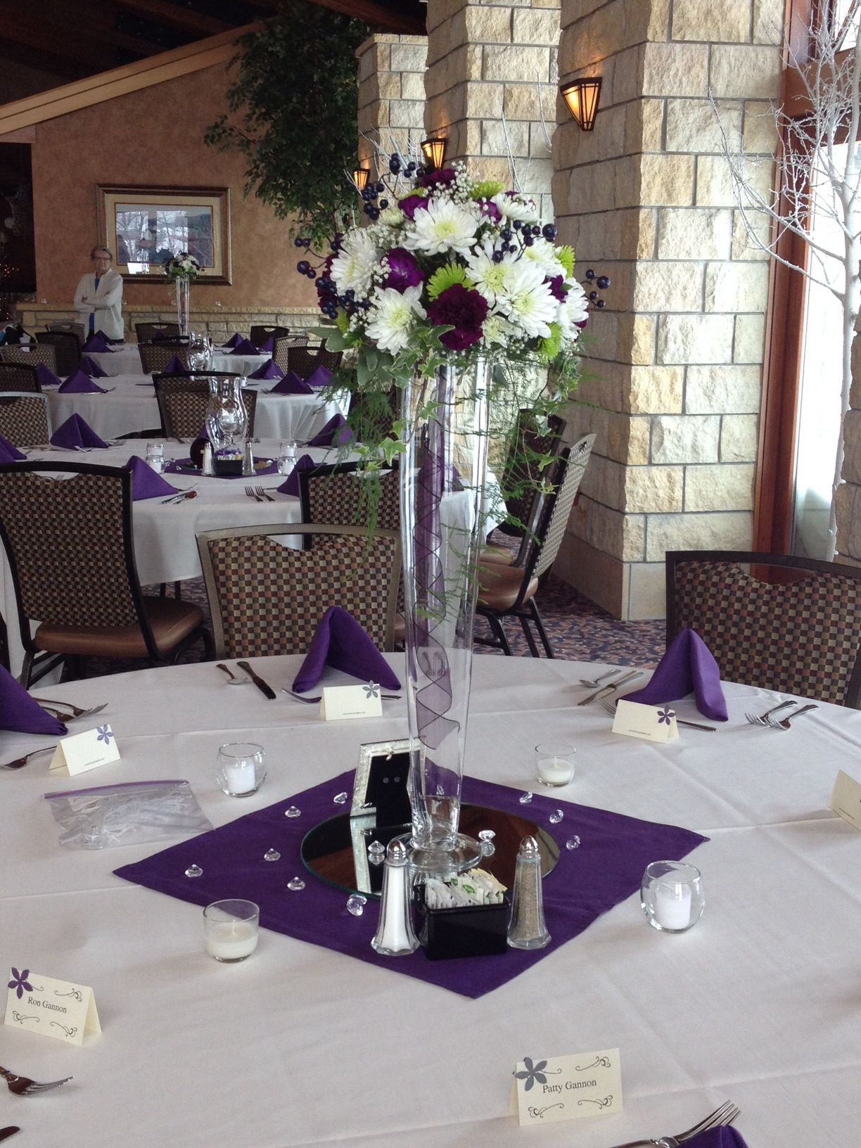 Wedding centerpiece cushion mums dark purple standard and mini cushion mums dark purple standard and mini carnations green athos mums with ivy placed in a tall pilsner vase reviewsmspy