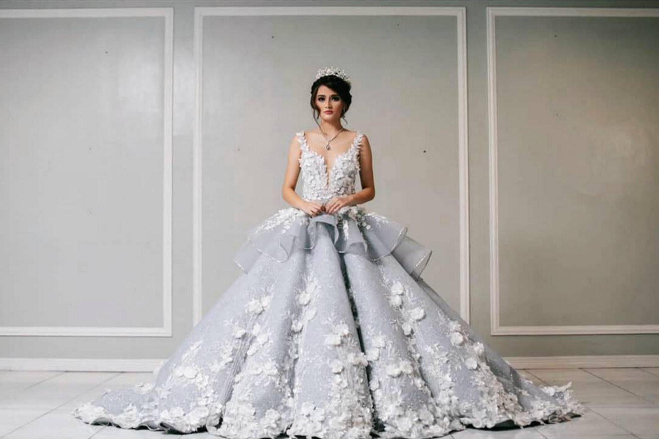 Blue wedding ball gown with white floral applique and pleated skirt