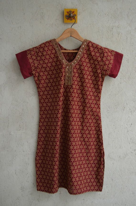 Cool vintage tunic.  Done in a burgundy with embroidered gold and beaded detail.  Not lined.  Can be worn with leggings, or just as a dress.