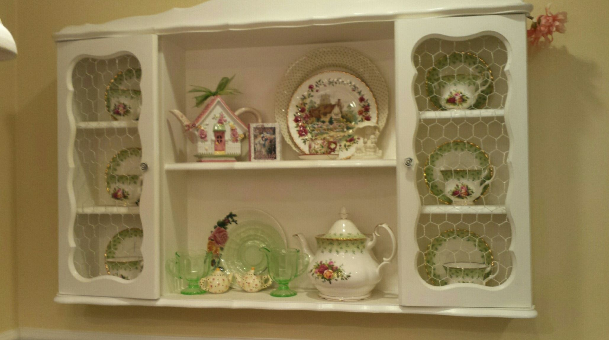 "Vintage cabinet on the kitchen wall above beadboard.  China is Royal Albert Old Country Roses ""Green""."