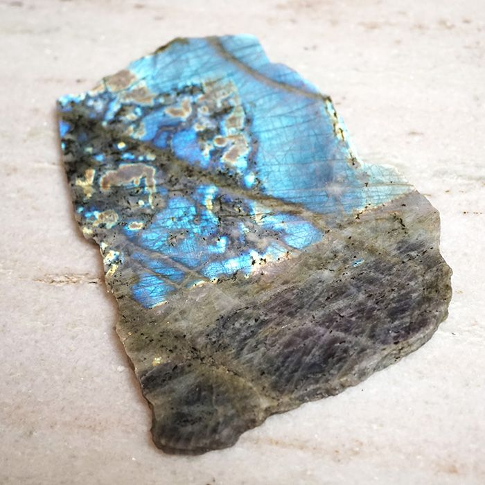 Legend Has It That Labradorite Is Frozen Fire Which Fell From The Aurora Borealis It Flashes Vibrant Blues And Gree Power Crystals Crystals Spiritual Crystals
