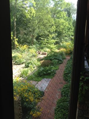 http://kleinspiration.com/bringing-garden-inside-look-inside-my/  Through the windows, looking outdoors is the children's garden and a quiet running brook.  This is a serene setting for young authors.  The students love going outside to write on a crisp fall day