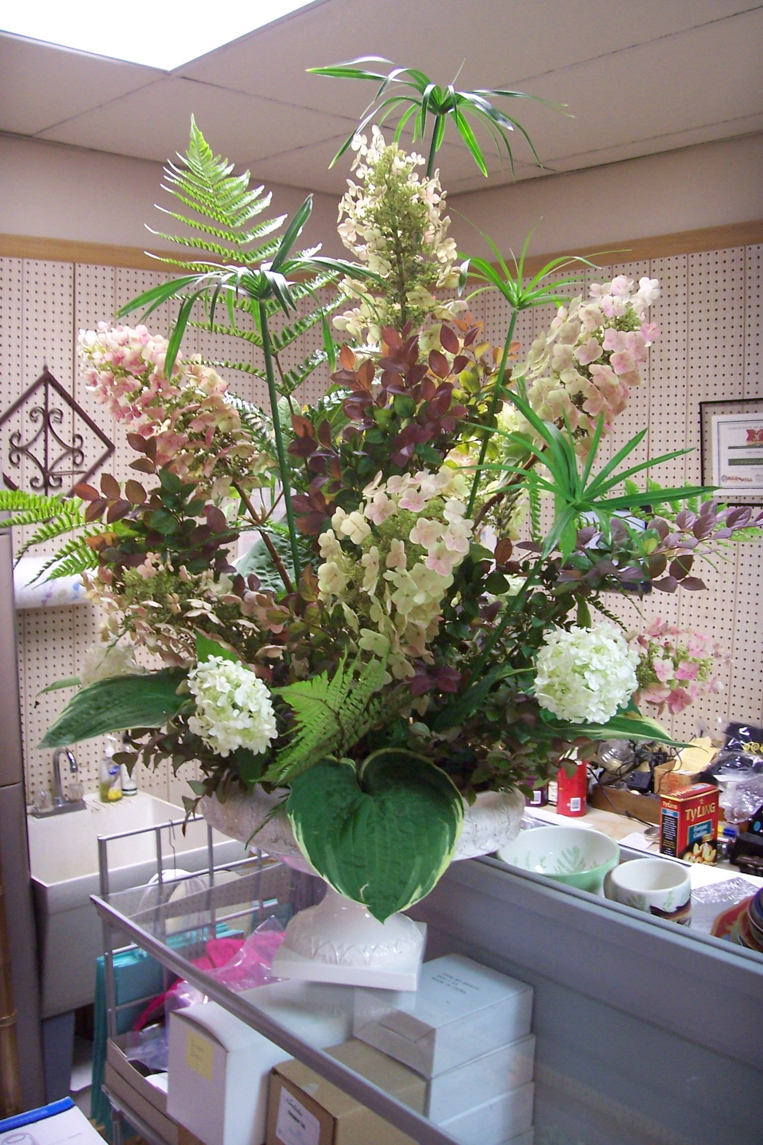 Arrangement using fresh oak leaf hydrangea ferns and
