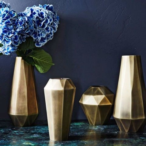 Faceted Metal Vases. In an antique brass finish with just the right amount of shine, our Faceted Metal Vases fuse the decadent architectural vibe of the '20s and '30s with a clean-lined modern feel.