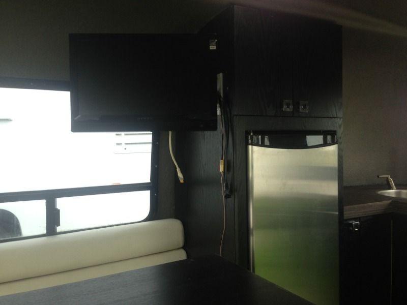 Steel green boler interior, LCD TV.