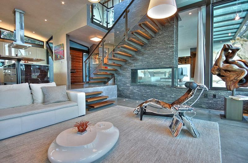 The sunken living room off the dining room is a perfect ...