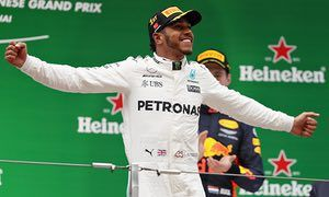Lewis Hamilton celebrates winning the Chinese F1 Grand Prix for Mercedes