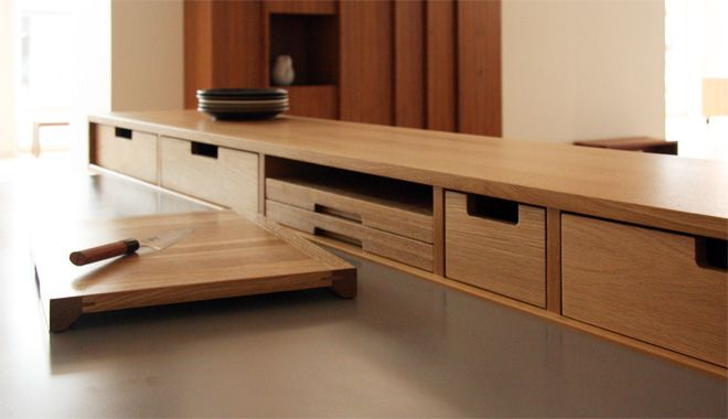 "The bar block is configured into storage modules: a drawer with an angled bottom supports spice jar storage, three solid wood sculpted cutting boards with anti-slide feet stack in another bay, another drawer has a fitted knife block capable of storing nine knives with blades up to 9"" long. Outlets and switches can also be built into the block. Each module can be tailored to suit the needs of ea"