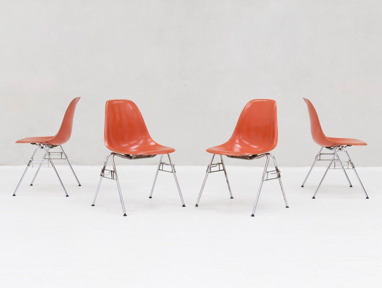set of 4 dss stacking chairs in fiberglass by charles ray eames