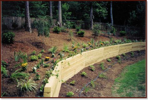 Angled 39 curved 39 retaining wall for Curved garden wall ideas