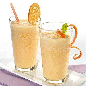 Put all ingredients in a blender with 1 cup of ice. Blend on high setting; slowly add more ice until Smoothie is desired thickness.