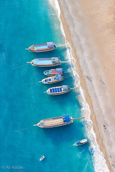 The beach at #Fethiye, Turkey • photo by Ali Kabas #travel #blue #boats #water #beautiful