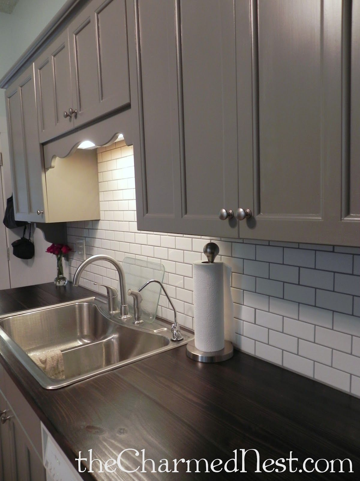 Pin by diane burd on vienna house ideas pinterest grey grout the charmed nest update kitchen this is almost exactly what i have in mind grey cabinets stainless hardware white subway tile back splash dailygadgetfo Gallery