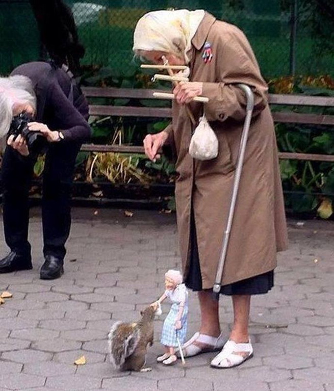 Old Lady Feeds Squirrels With Marionette of Herself – Earthly Mission