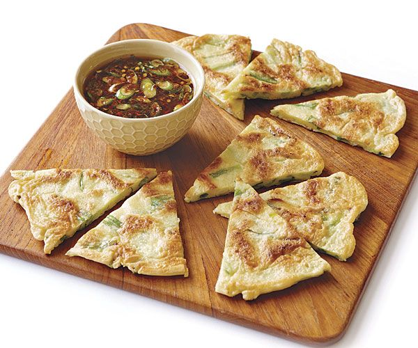 Korean-Style Scallion Pancakes and dipping sauce from Fine Cooking.  Reviewers love dipping sauce.