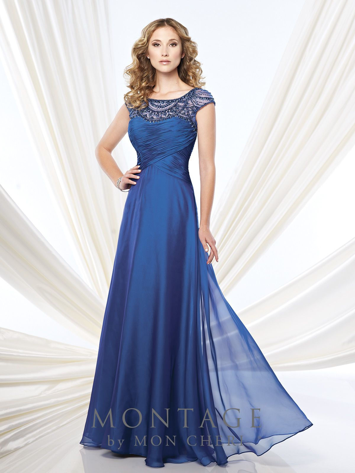 Two-tone chiffon A-line gown with hand-beaded illusion cap sleeves and bateau neckline, crisscross ruched semi-sweetheart bodice, beaded illusion keyhole back, sweep train. Matching shawl included. Sizes: 4 – 20, 16W – 26W
