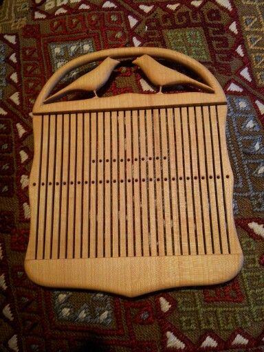 Rigid-heddle loom (grindvev). Bought at Norsk Folkemuseum. Gorgeous work!