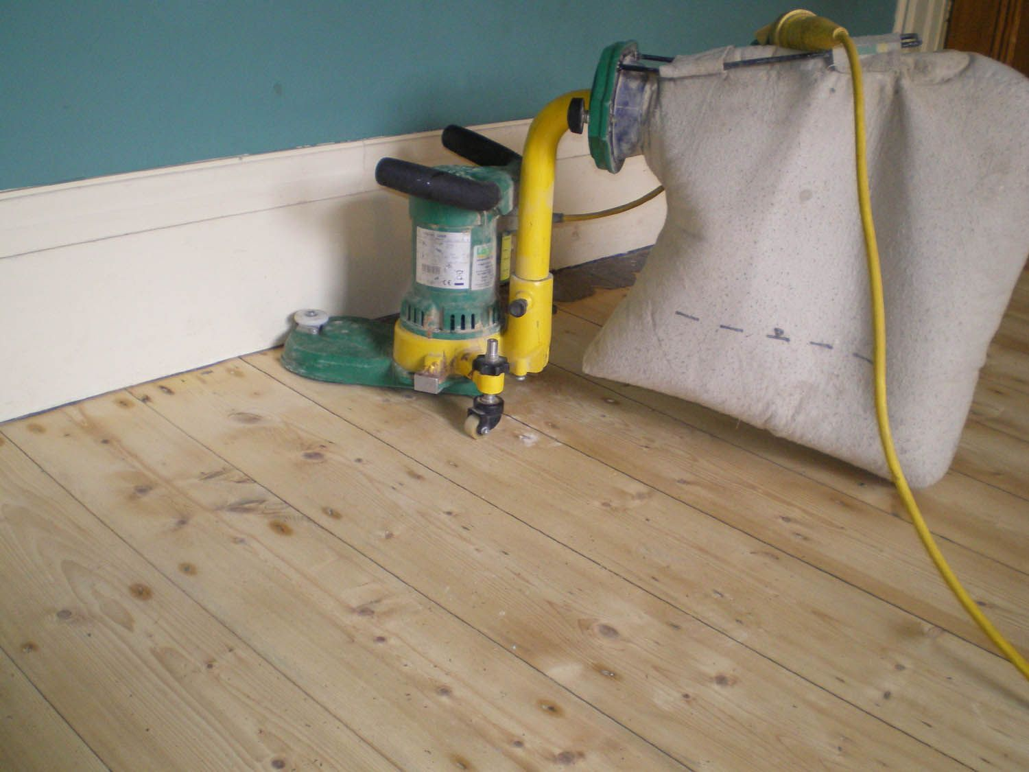 floor a drill brushes of to refinish and hardwood wraps rooms sandpaper around spaces sander floors drum how