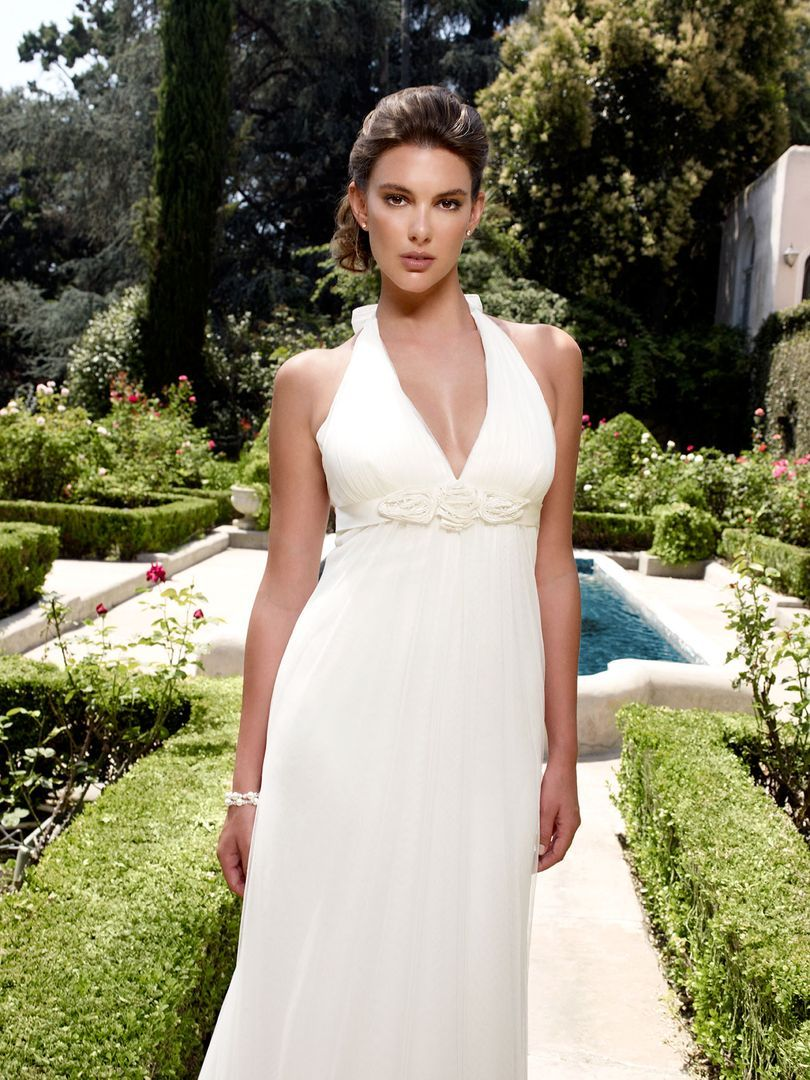 Plunging ucvud shaped halter neckline with soft netting over silky
