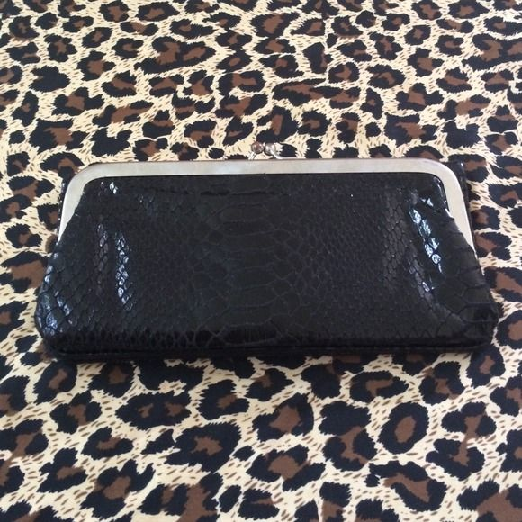 Black snake print wallet Black snakeskin wallet , hardly used. Great condition , tons of card pockets and a change pocket . unknown Bags Wallets