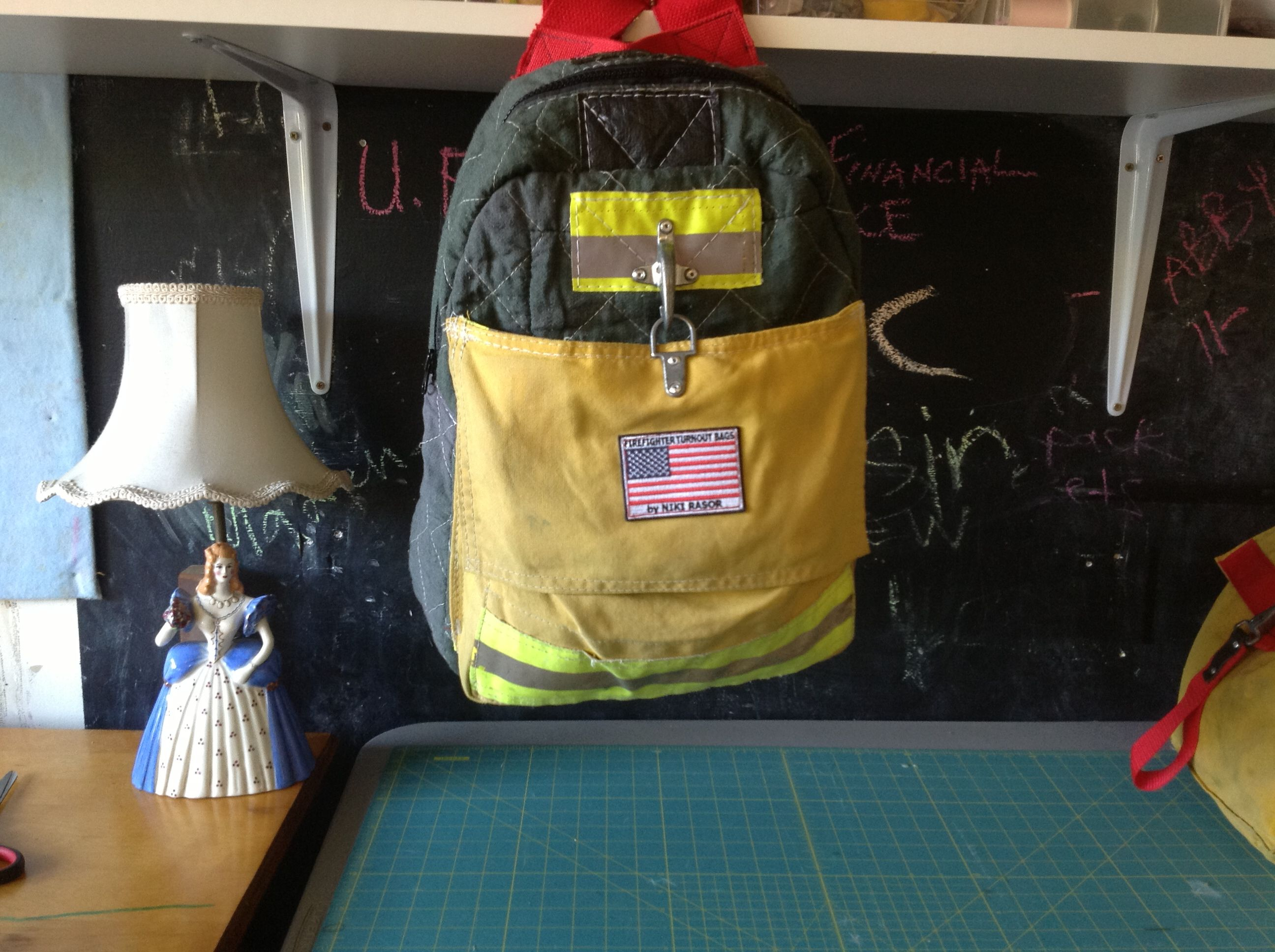 grey backpack hand made with recycled firefighter bunker gear is