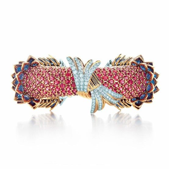 A design of fanciful creatures rises from the sea with an elegant flourish. Tiffany & Co. Schlumberger® Fish Bracelet with sapphires, red spinels and diamonds.