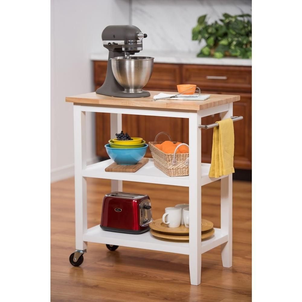 white kitchen cart with towel bar