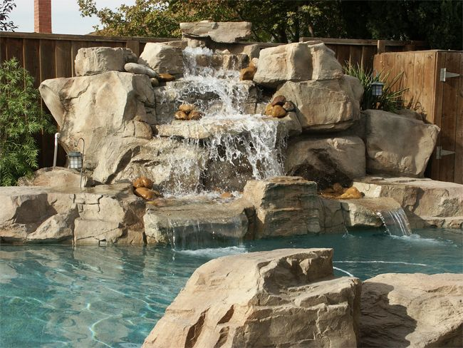 To Create A Realistic Looking Waterfall Follow Certain Design Rules When Stacking The Rocks So That T Swimming Pool Designs Waterfalls Backyard Rock Waterfall