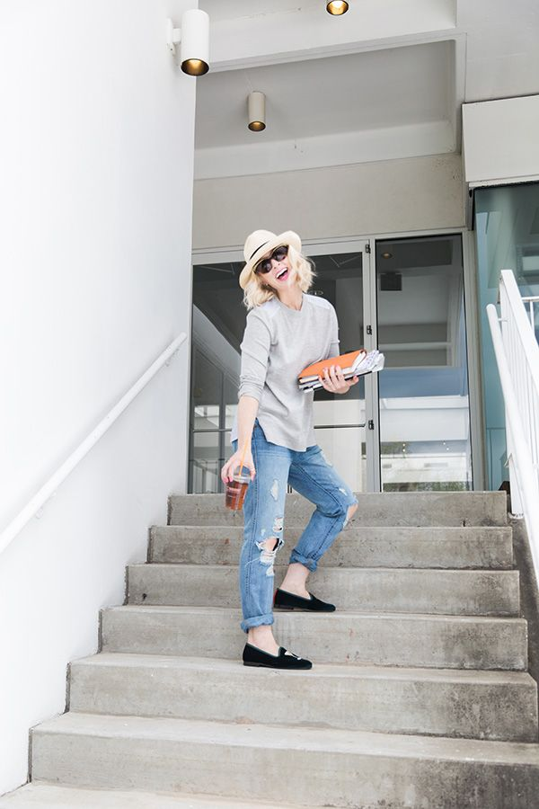 Mandy Kellogg Rye loves her some Dunkin' Donuts!   Boyfriend jeans and grey sweater