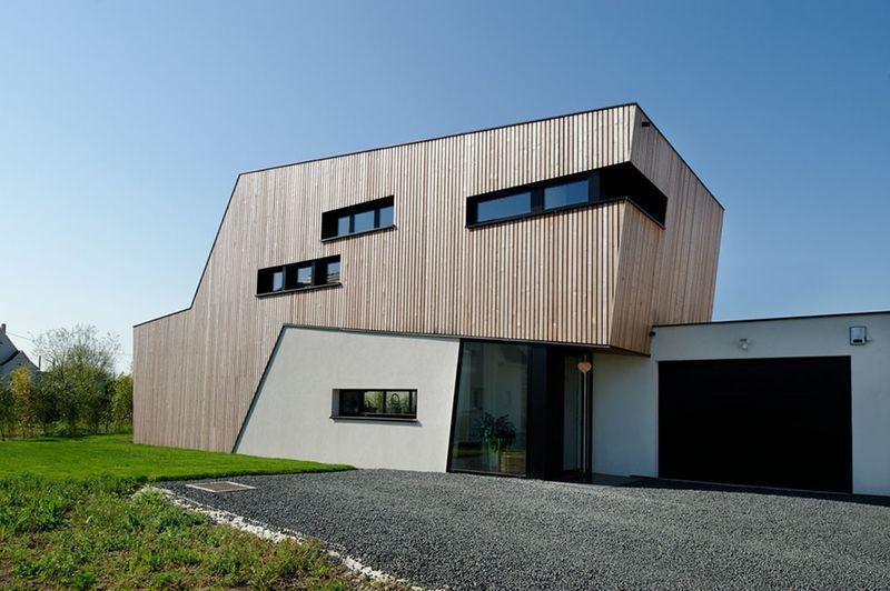 Maison contemporaine en L et son extension bois dans la