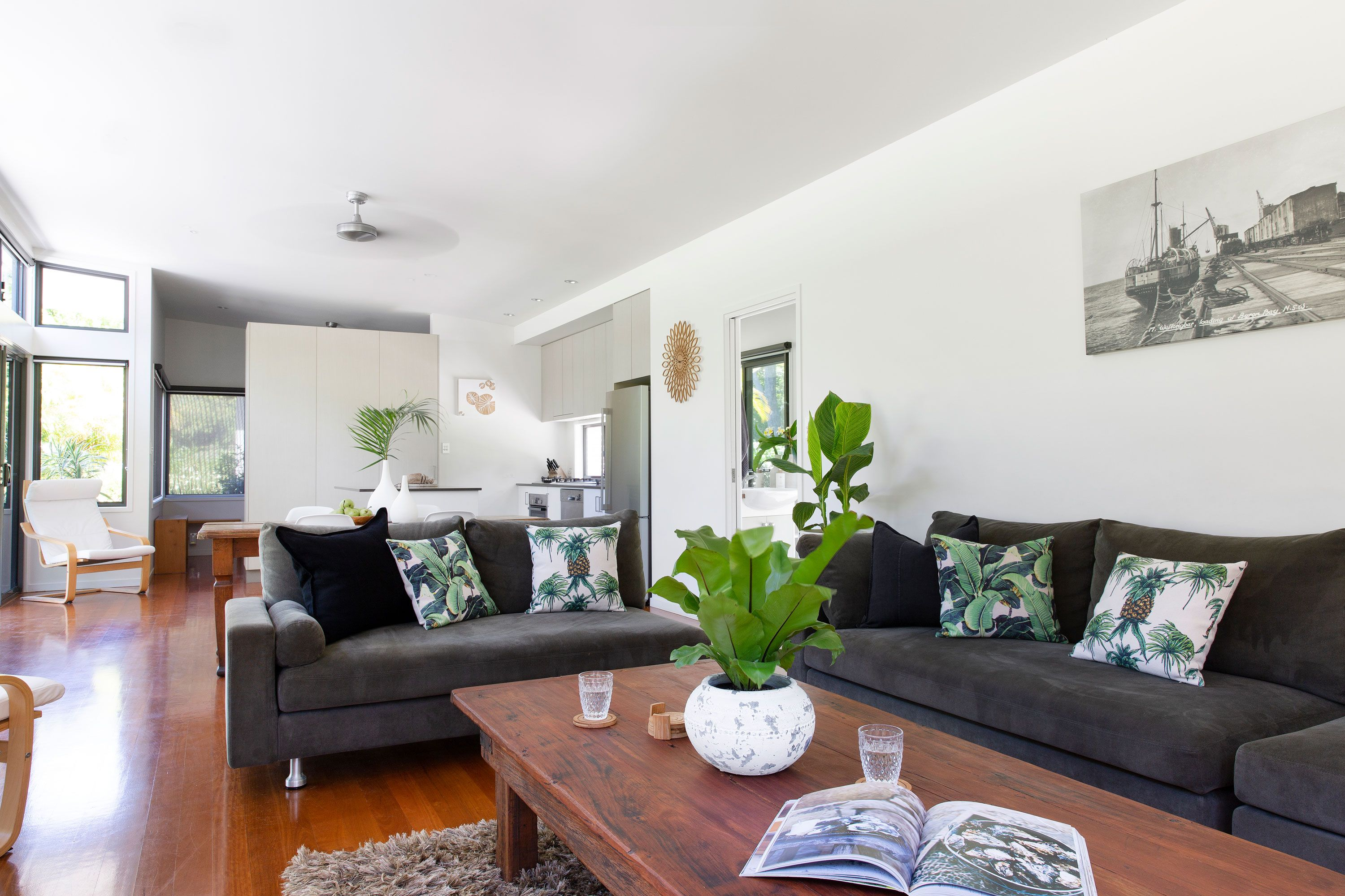 Crisp, white, open plan living at The Lily Pad at Byron