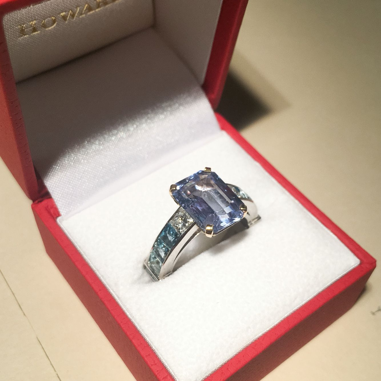Bespoke aquamarine and diamond ring, made by resetting the client's own stone.