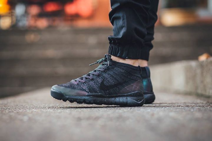 5b3f6ae3c4adf On foot look at the Nike Flyknit Trainer Chukka FSB Black. Available now.  http