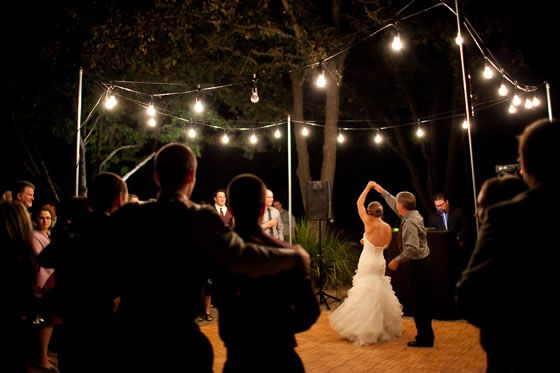 Elegant simplicity of an outdoor dance floor under a string of ...